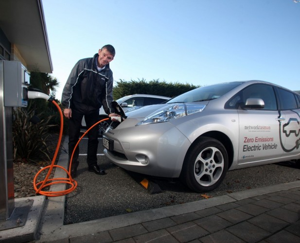 Network Tasman's Operations Manager Robert Derks with the company's new electric vehicle and charging station. PHOT: Tim Cuff